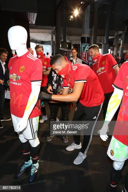 Heuer Art Provocateur Alec Monopoly Chris Smalling Victor Lindelof and Michael Carrick of Manchester United unveil new artwork at Old Trafford on...
