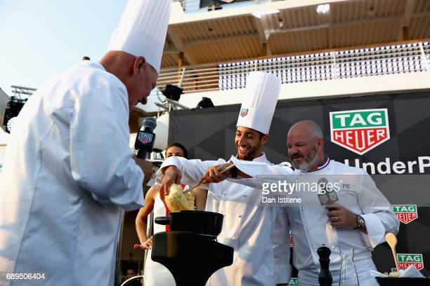 Heuer CEO JeanClaude Biver Daniel Ricciardo of Australia and Red Bull Racing and Chef Philippe Etchebest at the TAG Heuer Culinary Challenge on May...