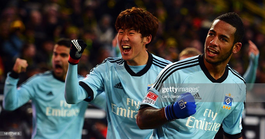Heung Min Son and <a gi-track='captionPersonalityLinkClicked' href=/galleries/search?phrase=Dennis+Aogo&family=editorial&specificpeople=787086 ng-click='$event.stopPropagation()'>Dennis Aogo</a> of Hamburg celebrate during the Bundesliga match between Borussia Dortmund and Hamburger SV at Signal Iduna Park on February 9, 2013 in Dortmund, Germany.