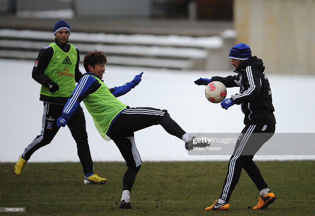 Heung Min Son and Rafael van der Vaart in action during a training session of Hamburg SV on January 23, 2013 in Hamburg, Germany.