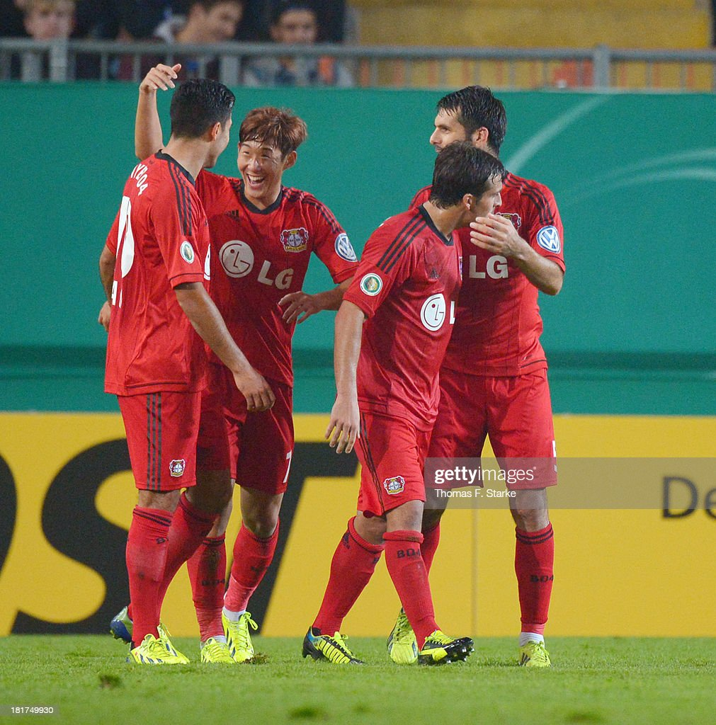 Heung - Min Son (2nd L) celebrates with his teammates during the DFB Cup match between Arminia Bielefeld and Bayer 04 Leverkusen at Schueco Arena on September 24, 2013 in Bielefeld, Germany.