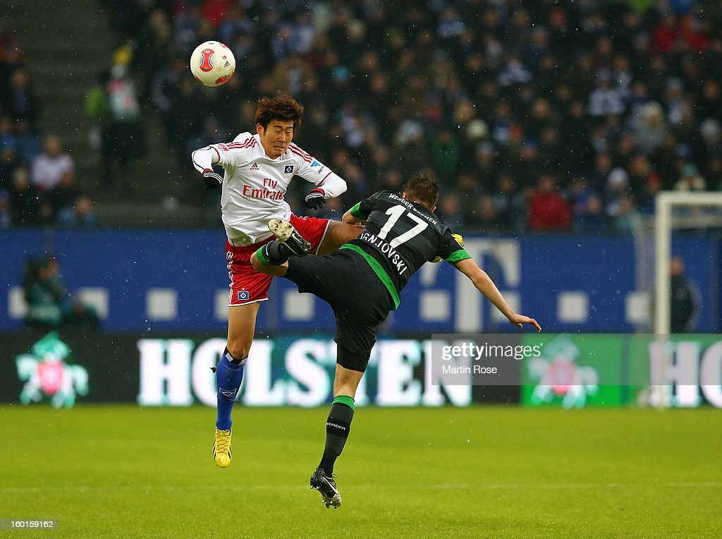 Heung Min Son (L) of Hamburg and <a gi-track='captionPersonalityLinkClicked' href=/galleries/search?phrase=Aleksandar+Ignjovski&family=editorial&specificpeople=6129439 ng-click='$event.stopPropagation()'>Aleksandar Ignjovski</a> (R) of Bremen battle for the ball during the Bundesliga match between Hamburger SV and SV Werder Bremen at Imtech Arena on January 27, 2013 in Hamburg, Germany.