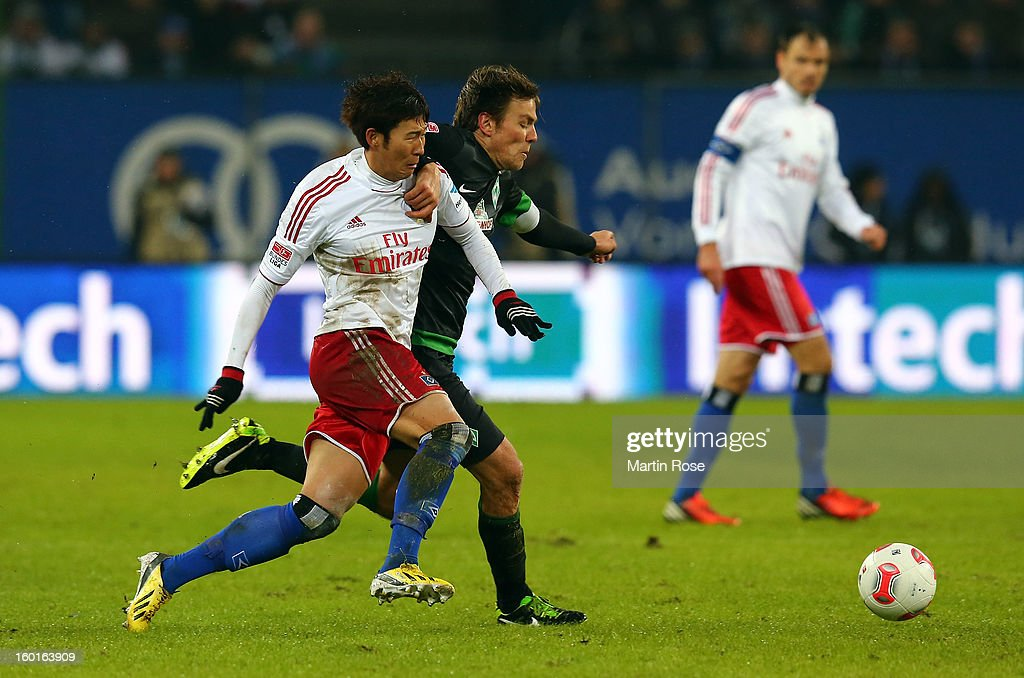Heung Min Son (L) of Hamburg and Clemsn Fritz(R) of Bremen battle for the ball during the Bundesliga match between Hamburger SV and SV Werder Bremen at Imtech Arena on January 27, 2013 in Hamburg, Germany.