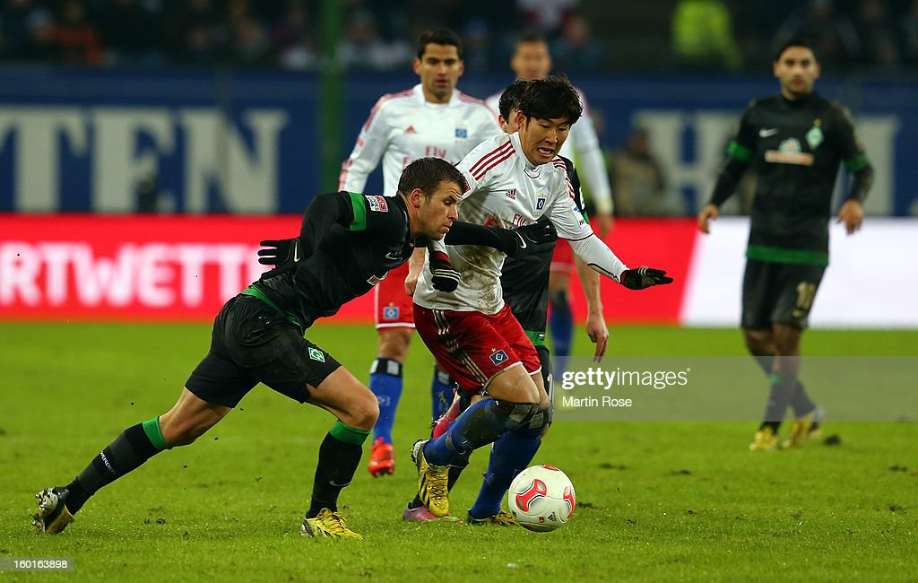Heung Min Son (R) of Hamburg and <a gi-track='captionPersonalityLinkClicked' href=/galleries/search?phrase=Lukas+Schmitz&family=editorial&specificpeople=6269299 ng-click='$event.stopPropagation()'>Lukas Schmitz</a> (L) of Bremen battle for the ball during the Bundesliga match between Hamburger SV and SV Werder Bremen at Imtech Arena on January 27, 2013 in Hamburg, Germany.
