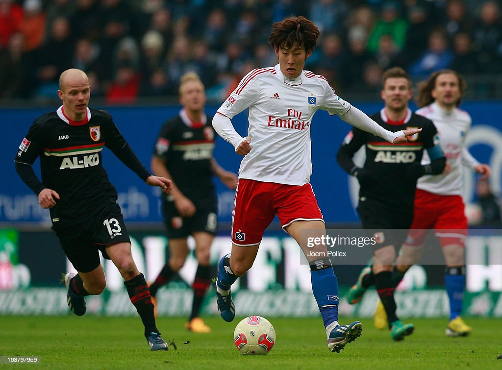 Heung Min Son (R) of Hamburg and Tobias Werner of Augsburg compete for the ball during the Bundesliga match between Hamburger SV and FC Augsburg at Imtech Arena on March 16, 2013 in Hamburg, Germany.