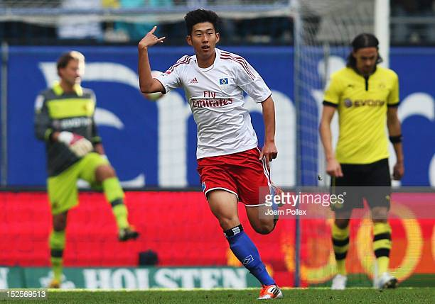 Heung Min Son of Hamburg celebrates after scoring his team's third goal during the Bundesliga match between Hamburger SV and Borussia Dortmund at...