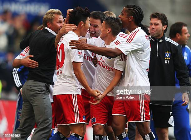 Heung Min Son of Hamburg celebrates with his team mates after scoring his team's third goal during the Bundesliga match between Hamburger SV and...
