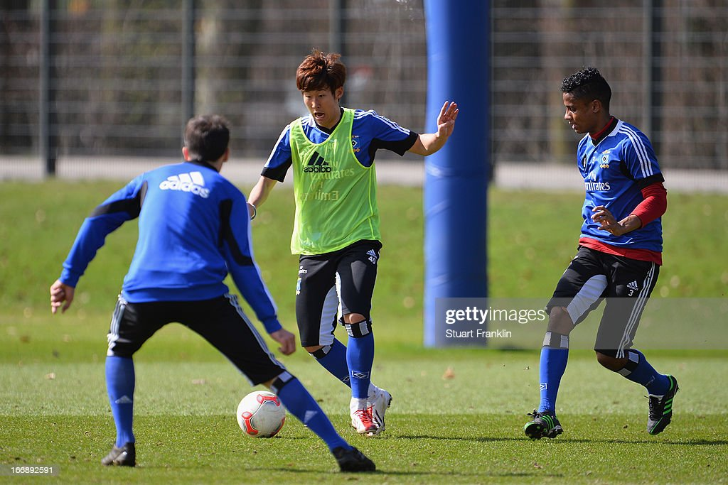 Heung Min Son of Hamburg in action with Michael Mancienne during a training session of Hamburger SV on April 18, 2013 in Hamburg, Germany.