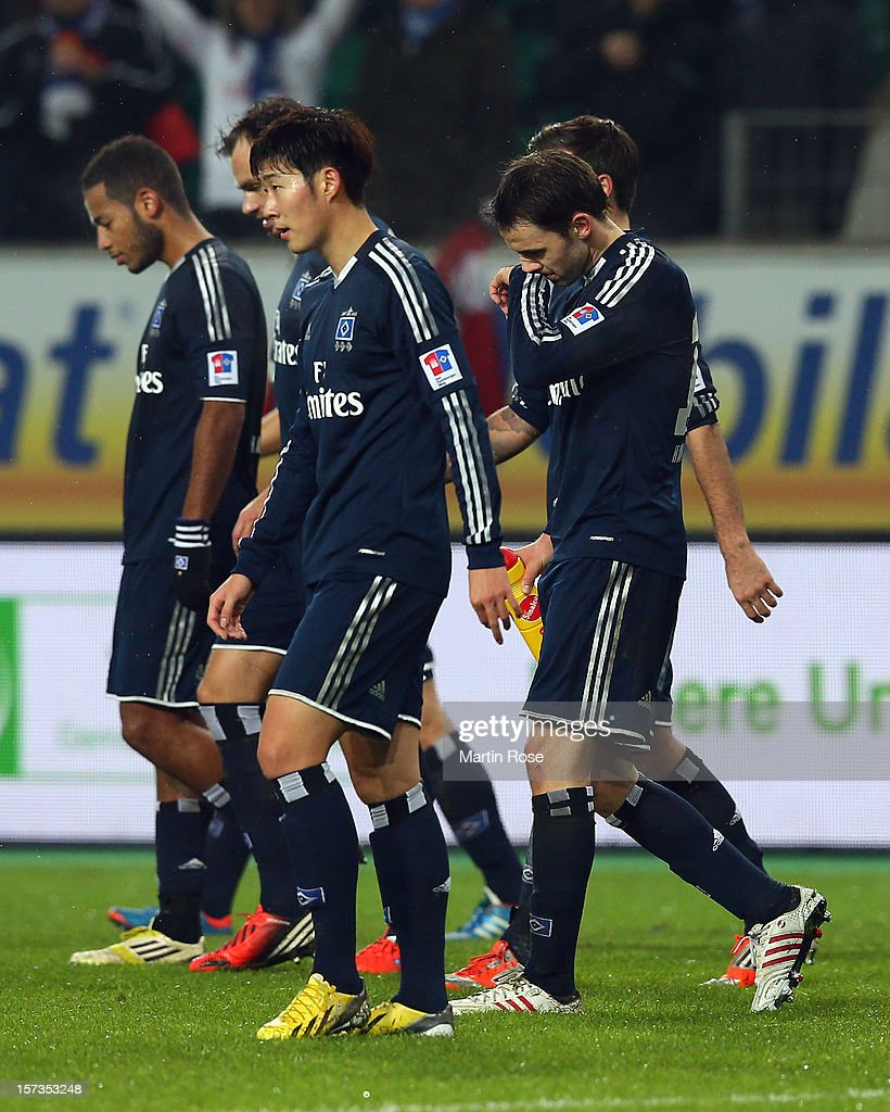 Heung Min Son (C) of Hamburg looks dejected after the Bundesliga match between VfL Wolfsburg and Hamburger SV at Volkswagen Arena on December 2, 2012 in Wolfsburg, Germany.
