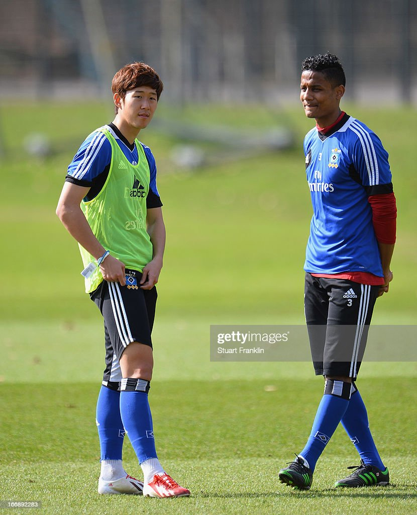 Heung Min Son of Hamburg talks with Michael Mancienne during a training session of Hamburger SV on April 18, 2013 in Hamburg, Germany.