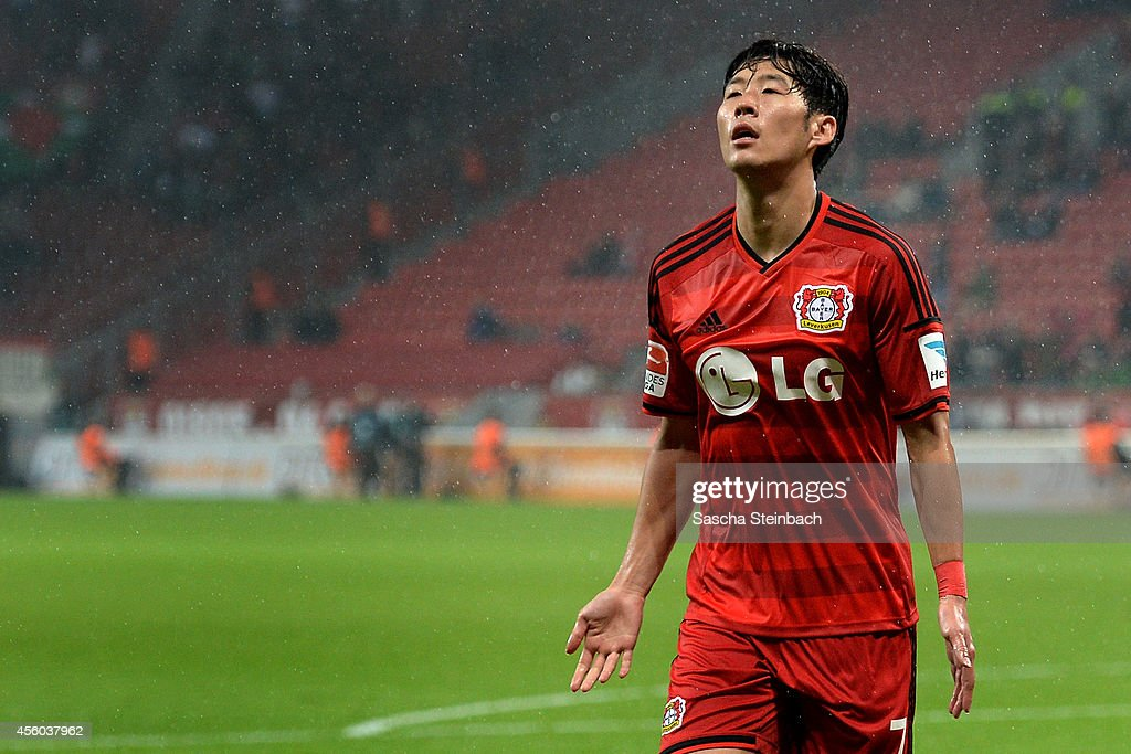 Heung Min Son of Leverkusen celebrates after scoring the opening goal during the Bundesliga match between Bayer 04 Leverkusen and FC Augsburg at BayArena on September 24, 2014 in Leverkusen, Germany.