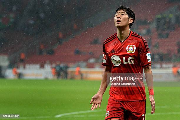 Heung Min Son of Leverkusen celebrates after scoring the opening goal during the Bundesliga match between Bayer 04 Leverkusen and FC Augsburg at...