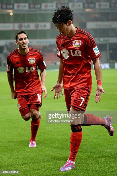 Heung Min Son of Leverkusen celebrates with team mate Hakan Calhanoglu after scoring the opening goal during the Bundesliga match between Bayer 04...