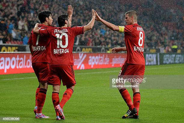 Heung Min Son of Leverkusen celebrates with team mates after scoring the opening goal during the Bundesliga match between Bayer 04 Leverkusen and FC...