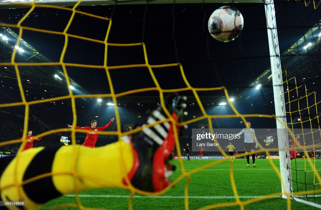 Heung Min Son of Leverkusen (not in the picture) scores his teams first goal during the Bundesliga match between Borussia Dortmund and Bayer Leverkusen at Signal Iduna Park on December 7, 2013 in Dortmund, Germany.