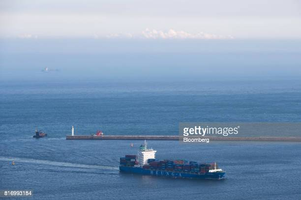 A HeungA Shipping Co container ship travels through the waters off Busan South Korea on Sunday July 16 2017 South Korea's exports will continue to...