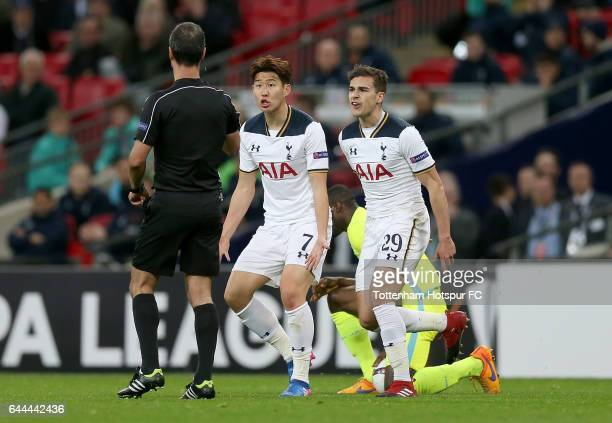 HeungMin Son and Harry Winks of Tottenham Hotspur react towards referee Manuel De Sousa during the UEFA Europa League Round of 32 second leg match...