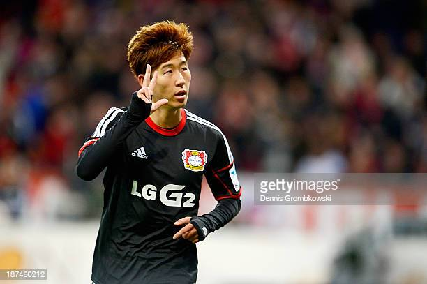 HeungMin Son of Bayer Leverkusen celebrates his third goal during the Bundesliga match between Bayer Leverkusen and Hamburger SV at BayArena on...