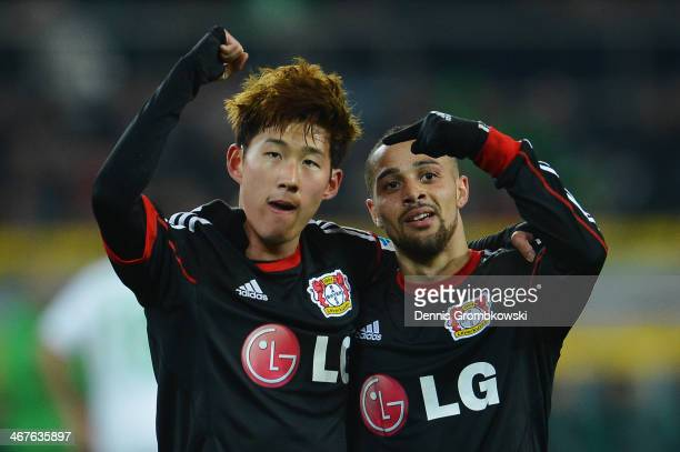 HeungMin Son of Bayer Leverkusen celebrates with team mate Sidney Sam after scoring his team's first goal during the Bundesliga match between...