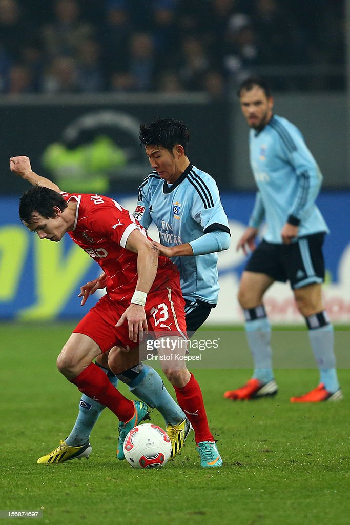 Heung-Min Son of Hamburg (R) challenges Robbie Kruse of Duesseldorf (L) during the Bundesliga match between Fortuna Duesseldorf and Hamburger SV at Esprit-Arena on November 23, 2012 in Duesseldorf, Germany.
