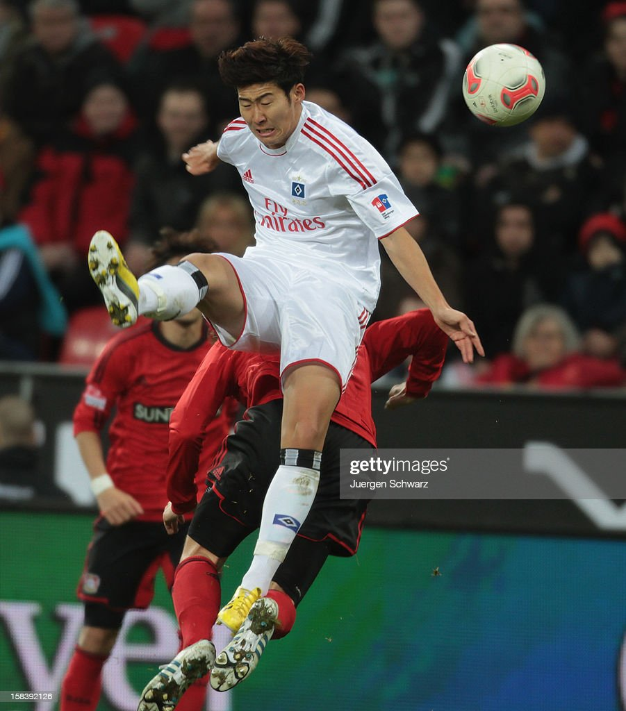 <a gi-track='captionPersonalityLinkClicked' href=/galleries/search?phrase=Heung-Min+Son&family=editorial&specificpeople=7118687 ng-click='$event.stopPropagation()'>Heung-Min Son</a> of Hamburg jumps onto <a gi-track='captionPersonalityLinkClicked' href=/galleries/search?phrase=Lars+Bender&family=editorial&specificpeople=644948 ng-click='$event.stopPropagation()'>Lars Bender</a> of Leverkusen during the Bundesliga match between Bayer Leverkusen and Hamburger SV at BayArena on December 15, 2012 in Leverkusen, Germany.