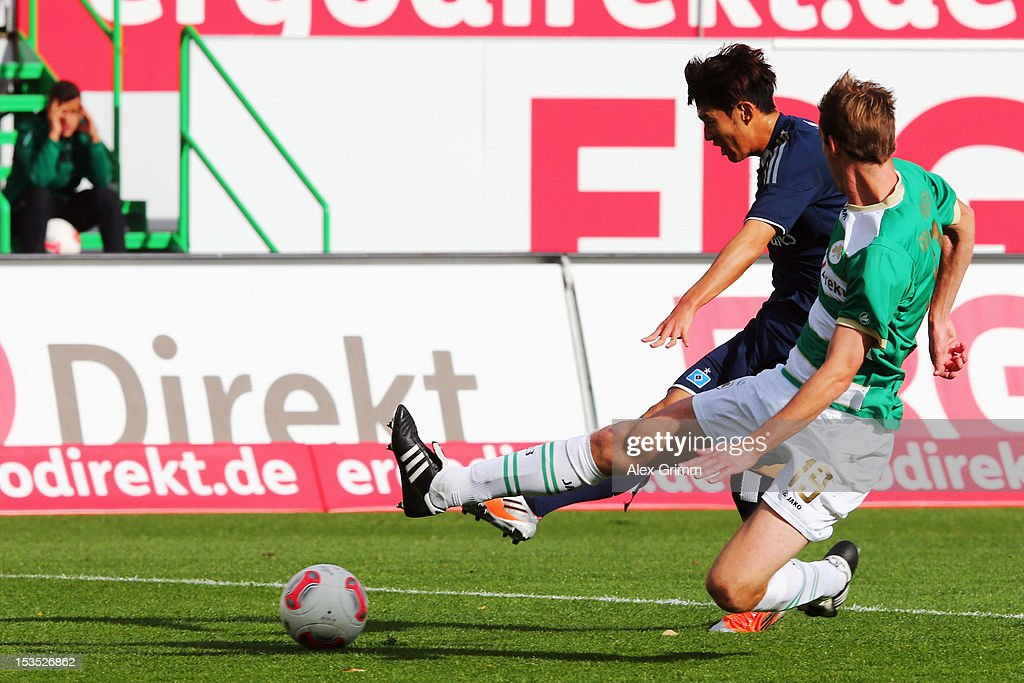 Heung-Min Son (back) of Hamburg scores his team's first goal against Thomas Kleine of Greuther Fuerth during the Bundesliga match between SpVgg Greuther Fuerth and Hamburger SV at Trolli-Arena on October 6, 2012 in Fuerth, Germany.
