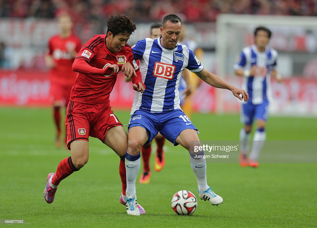 <a gi-track='captionPersonalityLinkClicked' href=/galleries/search?phrase=Heung-Min+Son&family=editorial&specificpeople=7118687 ng-click='$event.stopPropagation()'>Heung-Min Son</a> of Leverkusen (L) and <a gi-track='captionPersonalityLinkClicked' href=/galleries/search?phrase=Julian+Schieber&family=editorial&specificpeople=4272399 ng-click='$event.stopPropagation()'>Julian Schieber</a> of Berlin fight for the ball during the Bundesliga match between Bayer Leverkusen and Hertha BSC Berlin at BayArena on August 30, 2014 in Leverkusen, Germany.