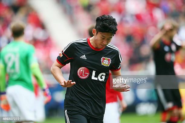 HeungMin Son of Leverkusen celebrates his team's first goal during the Bundesliga match between 1 FSV Mainz 05 and Bayer 04 Leverkusen at Coface...