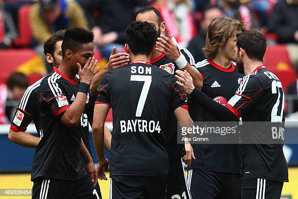HeungMin Son of Leverkusen celebrates his team's first goal with team mates during the Bundesliga match between 1 FSV Mainz 05 and Bayer 04...
