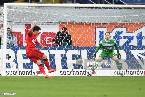 Heungmin Son of Leverkusen scores the opening goal past Paderborn's goalkeeper Lukas Kruse during the Bundesliga match between SC Paderborn and Bayer...