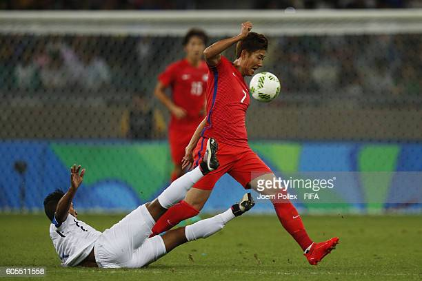 Heungmin Son of Republic of Korea and Bryan Acosta of Honduras compete for the ball during the Men's Quarter Final match between Republic of Korea...