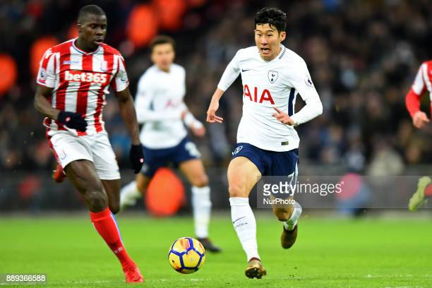 HeungMin Son of Tottenham chases the ball down from Stoke Citys Kurt Zouma during Premier League match between Tottenham Hotspur against Stoke City...