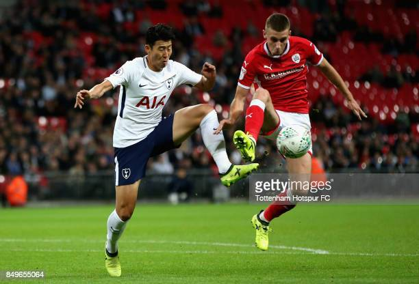HeungMin Son of Tottenham Hotspur and Angus MacDonald of Barnsley battle for possession during the Carabao Cup Third Round match between Tottenham...