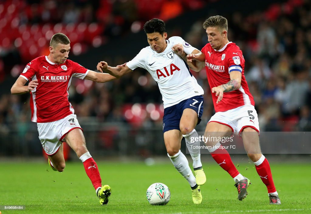 Heung-Min Son of Tottenham Hotspur and Angus MacDonald of Barnsley during the Carabao Cup Third Round match between Tottenham Hotspur and Barnsley at Wembley Stadium on September 19, 2017 in London, England.