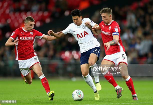 HeungMin Son of Tottenham Hotspur and Angus MacDonald of Barnsley during the Carabao Cup Third Round match between Tottenham Hotspur and Barnsley at...