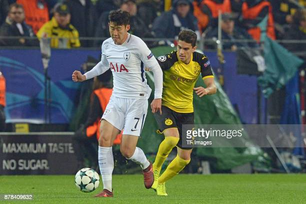 HeungMin Son of Tottenham Hotspur and Marc Bartra Aregall of Borussia Dortmund battle for the ball during the UEFA Champions League group H match...