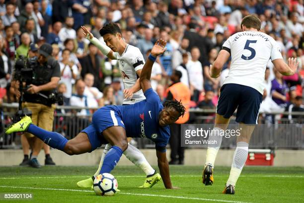 HeungMin Son of Tottenham Hotspur and Michy Batshuayi of Chelsea battle for possession during the Premier League match between Tottenham Hotspur and...