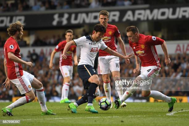 HeungMin Son of Tottenham Hotspur attempts to get past Phil Jones of Manchester United during the Premier League match between Tottenham Hotspur and...