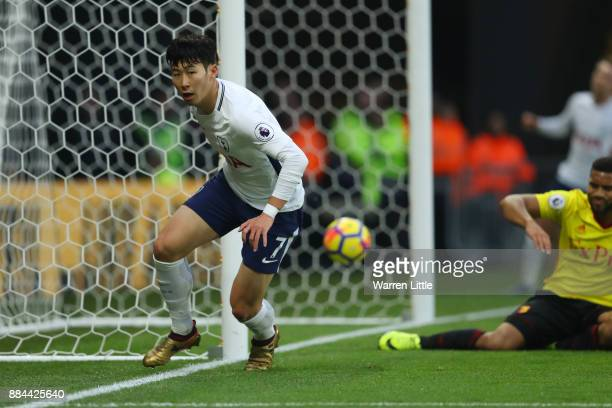 HeungMin Son of Tottenham Hotspur celebrates after scoring his sides first goal during the Premier League match between Watford and Tottenham Hotspur...