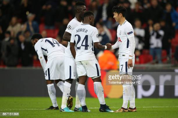HeungMin Son of Tottenham Hotspur celebrates after scoring his sides second goal with Serge Aurier of Tottenham Hotspur and Davinson Sanchez of...