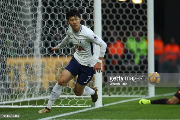 HeungMin Son of Tottenham Hotspur celebrates as he scores their first goal during the Premier League match between Watford and Tottenham Hotspur at...