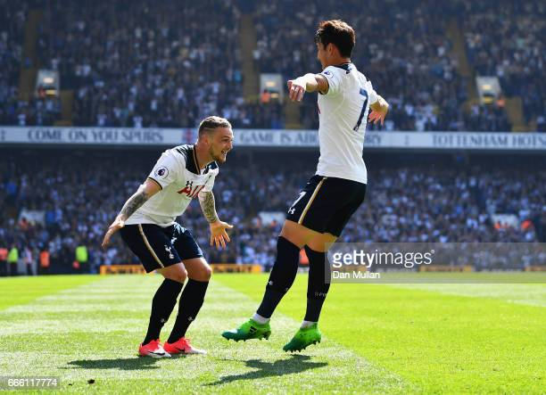 HeungMin Son of Tottenham Hotspur celebrates scoring his sides fourth goal with Kieran Trippier of Tottenham Hotspur during the Premier League match...