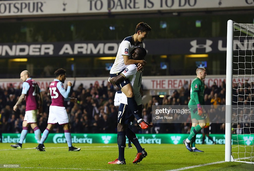 Heung-Min Son of Tottenham Hotspur celebrates scoring his sides second goal with Moussa Sissoko of Tottenham Hotspur (R) during The Emirates FA Cup Third Round match between Tottenham Hotspur and Aston Villa at White Hart Lane on January 8, 2017 in London, England.