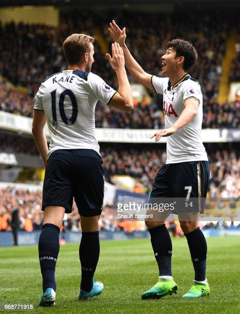 HeungMin Son of Tottenham Hotspur celebrates scoring his sides second goal with Harry Kane of Tottenham Hotspur during the Premier League match...