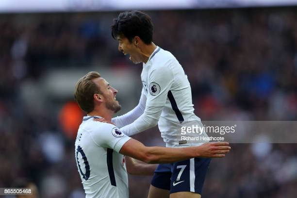 HeungMin Son of Tottenham Hotspur celebrates scoring his sides second goal with Harry Kane during the Premier League match between Tottenham Hotspur...
