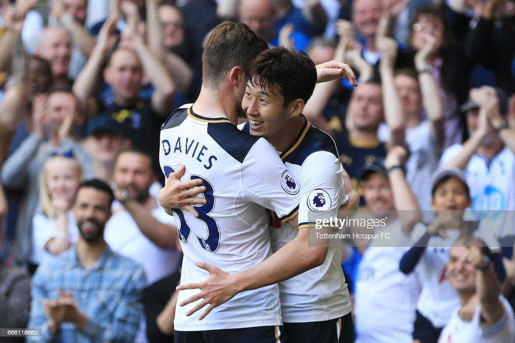 Heung-Min Son of Tottenham Hotspur (R) celebrates scoring his sides third goal with Ben Davies of Tottenham Hotspur (L) during the Premier League match between Tottenham Hotspur and Watford at White Hart Lane on April 8, 2017 in London, England.