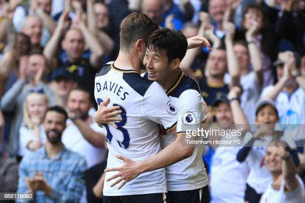 HeungMin Son of Tottenham Hotspur celebrates scoring his sides third goal with Ben Davies of Tottenham Hotspur during the Premier League match...