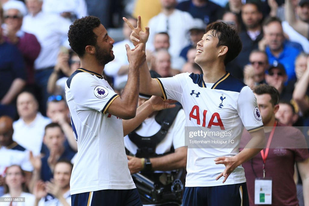 Heung-Min Son of Tottenham Hotspur (R) celebrates scoring his sides third goal with Mousa Dembele of Tottenham Hotspur (L) during the Premier League match between Tottenham Hotspur and Watford at White Hart Lane on April 8, 2017 in London, England.