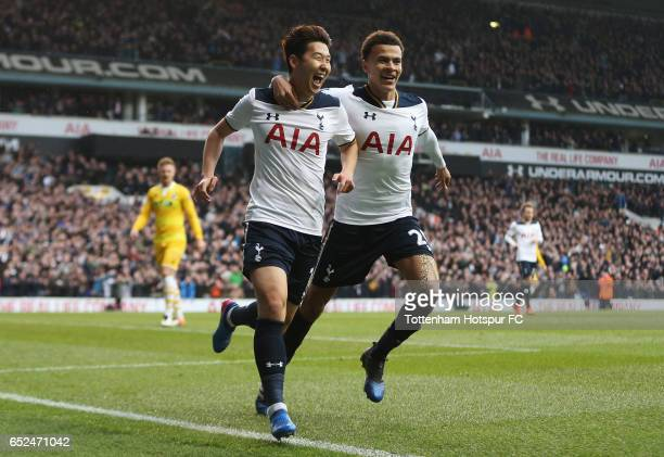 HeungMin Son of Tottenham Hotspur celebrates with Dele Alli as he scores his sides third goal during The Emirates FA Cup QuarterFinal match between...