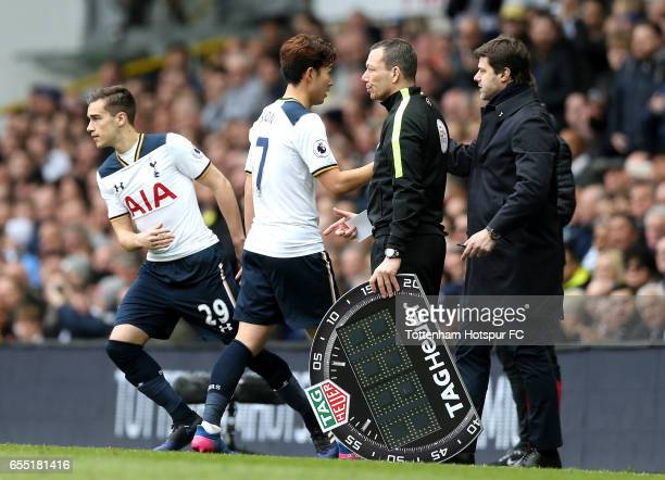 HeungMin Son of Tottenham Hotspur comes off for Harry Winks of Tottenham Hotspur during the Premier League match between Tottenham Hotspur and...